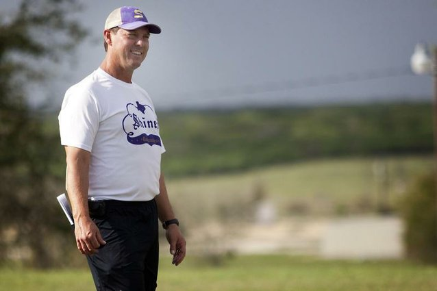 Comanches head coach Steven Cerny laughs during practice in Shiner on Monday.