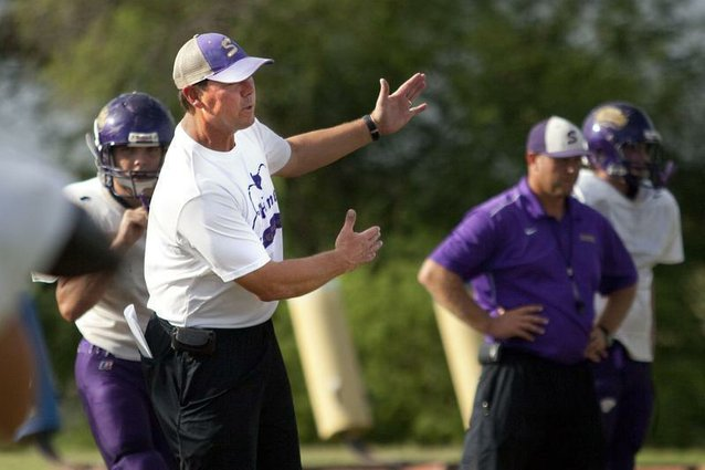 Shiner Comanches head coach Steven Cerny gives instructions during a drill in practice on Monday.